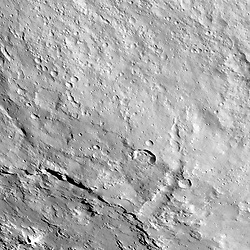 Jun 9, 2017 - Space - This image from NASA's Dawn spacecraft shows the northeastern rim of Urvara Crater on Ceres at lower left. To the right of the crater, the long, narrow feature that appears to jut out toward the north is called Pongal Catena, which is about 60 miles (96 km) long. Catenae are large grooves or troughs that can have various origins. They refer to chains of closely connected craters formed by a series of impacts, as found on Jupiter's moon Ganymede. They can also represent large faults created by internal forces, for example in this example found on Mars (see PIA20441). The mechanism that formed Pongal Catena is not understood yet, but it likely formed as a consequence of the stresses generated by the large impacts that resulted in the formation of the Urvara and Yalode craters. (Credit Image: © JPL-Caltech/UCLA/via ZUMA Wire)