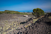 Old damaged abandoned building in lava field caused by volcanic eruption of Mount Etna active stratovolcano, Taormina, Sicily