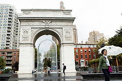 People pass by the Chinese activist and artist, Ai Weiwei's art project at Washington Square in New York,NY on October 12, 2017.   The artist assembeled 300 establishment around New York City statement  'Good Fences Make Good Neighbors'.  The works can be viewed through February 11, 2018. (Amir Levy/ SIPA USA)