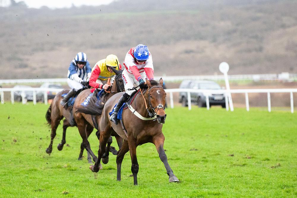 Ffos Las Racecourse, Trimsaran, Wales, UK. Monday 17 December 2018. Lamanver Pippin (jockey Harry Cobden) on the way to winning the Walters Group Novices' Hurdle (Race 4)