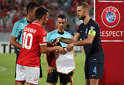 England's Jordan Henderson (right) and Malta's Andre Schembri exchange gifts before the 2018 FIFA World Cup Qualifying, Group F match at the National Stadium, Ta' Qali. PRESS ASSOCIATION Photo. Picture date: Friday September 1, 2017. See PA story SOCCER Malta. Photo credit should read: Nick Potts/PA Wire. RESTRICTIONS: Use subject to FA restrictions. Editorial use only. Commercial use only with prior written consent of the FA. No editing except cropping.