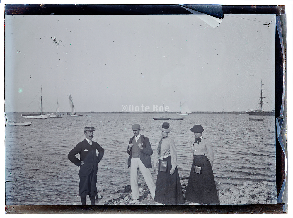 glass plate of people standing by water edge early 1900s