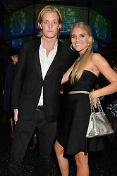 TIGERLILY TAYLOR and her brother RUFUS TAYLOR children of musician Roger Taylor at the Warner Music Group & Belvedere BRIT Awards After Party held at The Savoy, London on 19th February 2014.