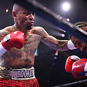 Luis Collazo (L) lands a left to the head of Keith Thurman during their Premier Boxing Champions boxing match for the WBA Welterweight title on ESPN at the USF Sun Dome, on Saturday, July 11, 2015 in Tampa, Florida.  Thurman won the bout when the corner of Collazo stopped the fight at the beginning of the eighth round. (AP Photo/Alex Menendez)