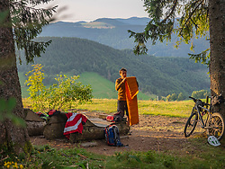 Mountain biker resting in the forest, Baden-Wuerttemberg, Germany