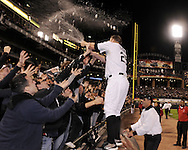 CHICAGO - SEPTEMBER 30:  Jim Thome #25 of the Chicago White Sox celebrates with the fans after the game against the Minnesota Twins at U.S. Cellular Field in Chicago, Illinois on September 30, 2008.  The White Sox defeated the Twins 1-0 to win the American League Central title.  Thome hit a solo home run for the only run of the game.  The Sox and Twins had to play a one game playoff to determine the American League Central Champion.  (Photo by Ron Vesely)