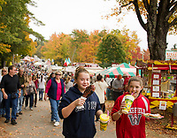 Traditional fair food vendors along the main walkway kept visitors happy as they came through the Sandwich Fair on Saturday.  (Karen Bobotas/for the Laconia Daily Sun)