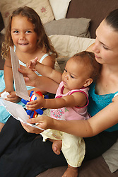 Mother or social worker with small children