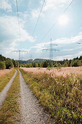 View of field with electricity pylon