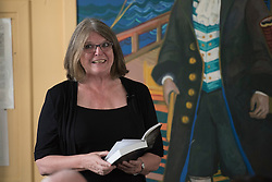 "A day of books in Portobello as part of the three-day long Portobello Book Festival. A series of packed events to hear a number of authors, some local, others from further afield talk about their writing. Pictured: Alison Baillie reads from her thriller ""Sewing the Shadows Together""<br /> <br /> <br /> © Jon Davey/ EEm"
