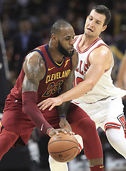 October 24, 2017 - Cleveland, OH, USA - The Cleveland Cavaliers' LeBron James, left, is pressured by the Chicago Bulls' Paul Zipser during the fourth quarter on Tuesday, Oct. 24, 2017, at Quicken Loans Arena in Cleveland. The Cavs won, 119-112. (Credit Image: © Phil Masturzo/TNS via ZUMA Wire)