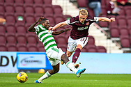Ismaila Soro (#19) of Celtic FC fouls Gary Mackay-Steven (#11) of Heart of Midlothian FC during the Cinch SPFL Premiership match between Heart of Midlothian FC and Celtic FC at Tynecastle Park, Edinburgh, Scotland on 31 July 2021.