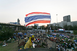 © Licensed to London News Pictures. 16/01/2014. An Anti Government protestor waves the thai flag at a Rally during the fourth day of the 'Bangkok Shutdown' as anti-government protesters continue with their 'shutdown' of Bangkok.  Major intersections in the heart of the city have been blocked in their campaign to oust Prime Minister Yingluck Shinawatra and her government in Bangkok, Thailand. Photo credit : Asanka Brendon Ratnayake/LNP
