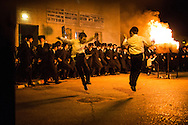 Young orthodox jews dancing next to the bonefire during the Lag BaOmer celebrations in the orthodox distric of Mea Shearim