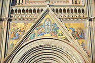 Close up of a gable with mosaics depicting the the Virgin Mary created between 1350 and 1390 after designs by artist Cesare Nebbia on the14th century Tuscan Gothic style facade of the Cathedral of Orvieto, designed by Maitani, Umbria, Italy .<br /> <br /> Visit our ITALY HISTORIC PLACES PHOTO COLLECTION for more   photos of Italy to download or buy as prints https://funkystock.photoshelter.com/gallery-collection/2b-Pictures-Images-of-Italy-Photos-of-Italian-Historic-Landmark-Sites/C0000qxA2zGFjd_k<br /> .<br /> <br /> Visit our MEDIEVAL PHOTO COLLECTIONS for more   photos  to download or buy as prints https://funkystock.photoshelter.com/gallery-collection/Medieval-Middle-Ages-Historic-Places-Arcaeological-Sites-Pictures-Images-of/C0000B5ZA54_WD0s