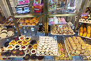 Traditional Spanish biscuits, pastries and cakes as gifts and souvenirs in shop Yema de Avila in Plaza Mayor in Avila, Spain