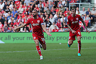 Bristol Aaron Wilbraham (18) celebrates his goal with tema mate Tammy Abraham (9). Making it 1-1.   during the EFL Sky Bet Championship match between Bristol City and Derby County at Ashton Gate, Bristol, England on 17 September 2016. Photo by Gary Learmonth.