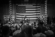 Roy Moore speaks to supporters in Fairhope, Alabama on December 5, 2017 at a rally before the up comming election, his wife listens to him. The rally was held in a large barn.