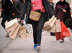Embargoed to 0001 Thursday February 21 File photo dated 06/12/11 of a person with shopping bags. The Government should urgently consider an online sales tax to help secure the future of the high street but local retailers must do more to offer the personal interaction that the likes of Amazon cannot, MPs have urged.