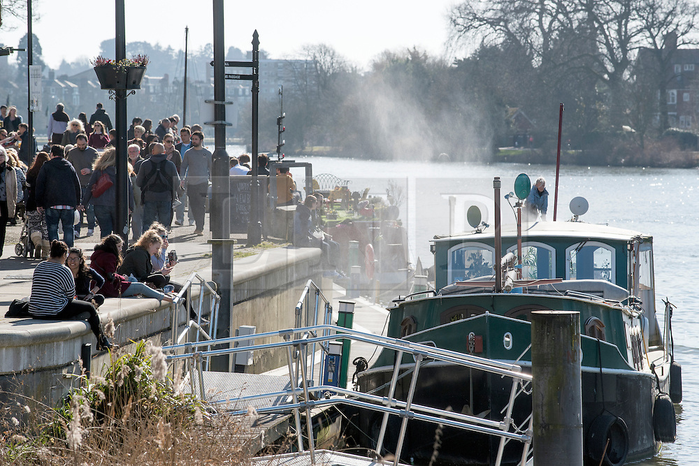 © Licensed to London News Pictures. 07/03/2015. Kingston, UK People relax by the River Thames in the fine weather in Kingston, Surrey, today 7th March 2015. Photo credit : Stephen Simpson/LNP