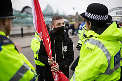 "© Licensed to London News Pictures . 21/03/2015 . Newcastle , UK . A man is arrested at the demo . Neo-Nazis and skinheads from across Europe organise a "" White Man March "" in Newcastle , under the banner of "" National Action "" . Photo credit : Joel Goodman/LNP"