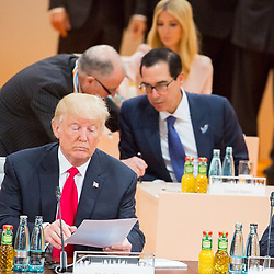 "Donald Trump releases a photo on Instagram with the following caption: ""President Trump at #G20Summit meeting today. Behind him, U.S. Treasury Secretary Steven Mnuchin \u0026 Assistant to the President, @ivankatrump. #USA #Hamburg #Germany"". Photo Credit: Instagram *** No USA Distribution *** For Editorial Use Only *** Not to be Published in Books or Photo Books ***  Please note: Fees charged by the agency are for the agency's services only, and do not, nor are they intended to, convey to the user any ownership of Copyright or License in the material. The agency does not claim any ownership including but not limited to Copyright or License in the attached material. By publishing this material you expressly agree to indemnify and to hold the agency and its directors, shareholders and employees harmless from any loss, claims, damages, demands, expenses (including legal fees), or any causes of action or allegation against the agency arising out of or connected in any way with publication of the material."