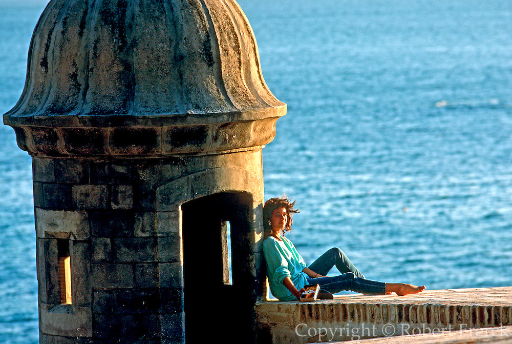 PUERTO RICO, SAN JUAN World Heritage Site; city walls and guard tower overlooking San Juan Gate and the harbor entrance