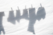 clothing projected on a sheet hanging to dry