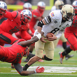 10 November 2012: Army Black Knights quarterback Trent Steelman (8) escapes a tackle attempt by Rutgers Scarlet Knights defensive back Duron Harmon (32) during NCAA college football action between the Rutgers Scarlet Knights and Army Black Knights at High Point Solutions Stadium in Piscataway, N.J.. Rutgers defeated Army 28-7.