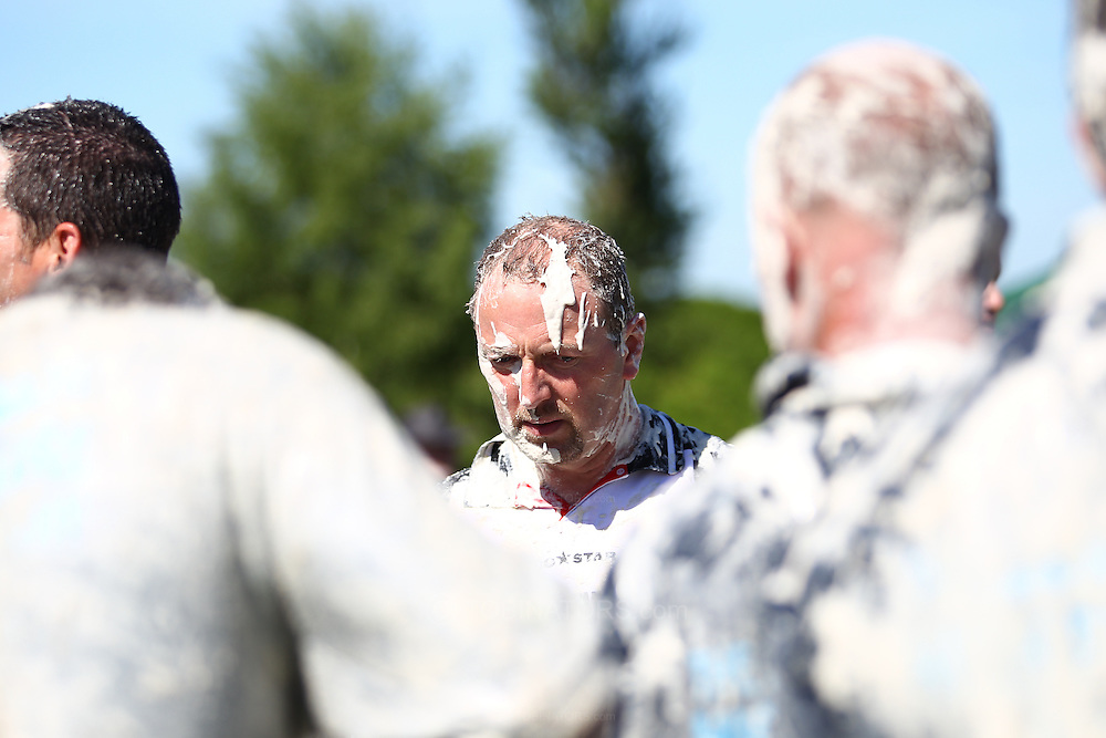 Coxheath, Kent - Saturday, May 22nd 2010: A competitor from the Coxheath team looks on at the World Custard Pie Championships at Coxheath near Maidstone, Kent. The first championship was held in 1967 in Coxheath using a special custard recipe developed by Richard Hearn aka Mr Pastry. The championship is made up of teams competing in heats, semi finals and the final, with the number of pies available per team increasing from 5 in the heats to 10 in the final. 6 points are scored for a direct hit on the face, 3 points for the shoulders or upwards, 1 point for any other part of the body, and points are deducted for misses. A discretionary 5 points can be awarded for the most amusing and original throwing technique. The event is part of the Rotary Club funday. (Pic by Andrew Tobin/SLIK Images)