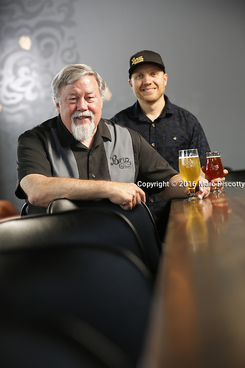 SHOT 7/22/16 2:01:00 PM - Bruz Beers co-founders Charlie Gottenkieny and Ryan Evans inside the new brewery near 67th Avenue and Pecos in Denver, Co. Bruz Beers is Denver's artisanal Belgian-style brewery, featuring a full line of traditional and Belgian-inspired brews, hand-crafted in small batches. Includes images of Evan's dog 'Cooper' as well who serves as the brewery dog. (Photo by Marc Piscotty / © 2016)