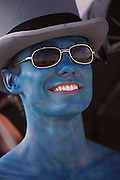 Ed from London was painted blue with top hat and sunglasses at Burning Man. Burning Man is a performance art festival known for art, drugs and sex. It takes place annually in the Black Rock Desert near Gerlach, Nevada, USA.