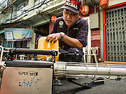 02 DECEMBER 2015 - BANGKOK, THAILAND:  A health department mosquito control worker loads his sprayer with the chemicals used to kill mosquitoes before spraying a neighborhood in Bangkok. The Public Health Ministry in Thailand said that more than 111,000 cases of dengue fever have been reported in 2015, an increase of more than 200% over the number of cases of dengue fever reported 2014. Dengue fever is a virus spread by mosquito and is endemic in southeast Asia. Thai health officials are aggressively spraying areas where mosquitoes are known to live and leading public information and education sessions on preventing dengue fever. There is no vaccine for dengue fever, so preventing dengue means avoiding mosquitoes.       PHOTO BY JACK KURTZ