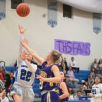 Laguna-Acoma Hawk Alenna Scott (22) drives to the basket for a layup Friday night against the Tucumcari Rattlers at Laguna-Acoma Jr Sr High School in Casa Blanca.