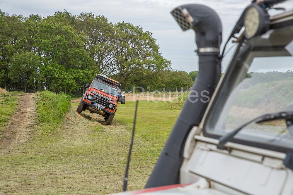 Off road 4X4 experience with the Suffolk Land Rover Owners Club display at the annual Suffolk Show at the Suffolk Show Ground on the 29th May 2019 in Ipswich in the United Kingdom. The Suffolk Show is an annual show that takes place in Trinity Park, Ipswich in the English county of Suffolk. It is organised by the Suffolk Agricultural Association.