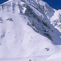 "SKIING, Big Sky, MT. Patrick Shanahan (MR) skis ""Upper Morning Star"" run below Triple Chair. Lone Mt. bkg."