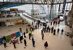 © Licensed to London News Pictures. 11/11/2020. London, UK. Commuters stop at 11am for the two minute silence on Armistice Day at Waterloo Station, London. At 11am a two minute silence was held throughout the UK to mark the end of the 1st World War. At Westminster Abbey the centenary of the Unknown Warrior will be commemorated at a service where Prince Charles and the Duchess of Cornwall along with members of the Government and armed forces are expected to attend. Photo credit: Alex Lentati/LNP