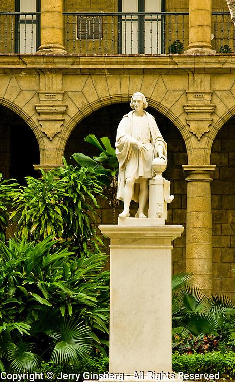 Statue of Christopher Columbus in the courtyard of the Palacio de Los Capitanes Generales, Palace of the Captain Generals in Plaza de Armas, Old Havana, Habana Vieja, Cuba.