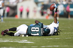 Detroit Lions free safety Louis Delmas (26) holds the ball up after intercepting a pass and being tackled by Philadelphia Eagles wide receiver Jason Avant (81) during the NFL game between the Detroit Lions and the Philadelphia Eagles on Sunday, October 14th 2012 in Philadelphia. The Lions won 26-23 in Overtime. (Photo by Brian Garfinkel)
