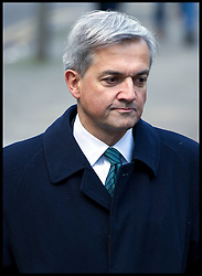 Former energy secretary Chris Huhne arrives with his partner Carina Trimingham for the start of his trial with his ex-wife Vicky Pryce over speeding penalty. The former couple are both accused of perverting the course of justice. It is alleged that Huhne persuaded Pryce to take his penalty points for a speeding offence in 2003, South Crown Court, London, Monday February 4, 2013. Photo By Andrew Parsons / i-Images