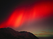 Brilliant red and green aurora above Arkose Ridge during geomagnetic storm on the night of November 5, 2001, Talkeetna Mountains, Alaska.