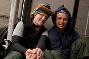 """Erin Hoover (left) a teacher from Canada and Emma Homerline (right) a teacher from Australia part of team 60 Peace Boat volunteers known as the """"fish guys"""" after removing 18 tonnes of rotten fish from a damaged warehouse during the clean-up operations in Ishinomaki, Miyagi Friday May 6th 2011. Around 350 volunteers took part in the relief effort over the Golden Week holiday, including 41 foreigners, clearing mud and removing debris from this coastal town which more almost levelled in the March 11th earthquake and tsunami."""