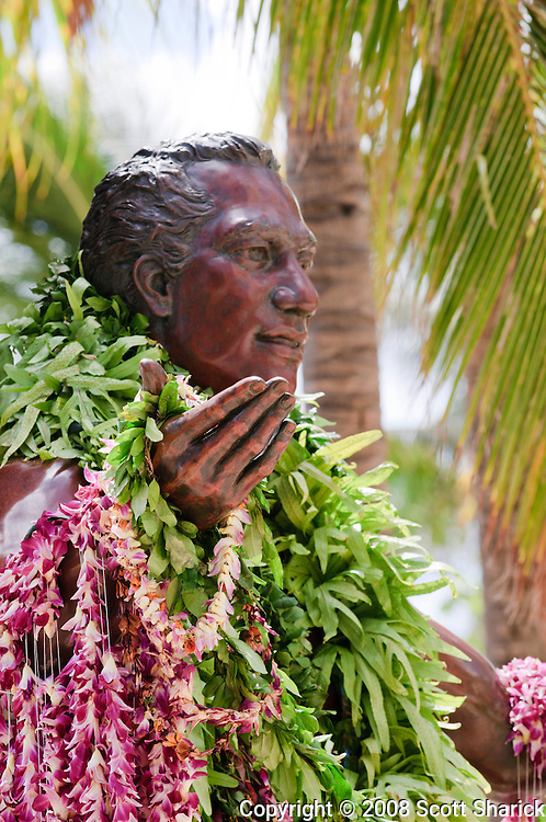 The famous surfer, Duke Kahanamoku statue in Waikiki with colorful lei draped across his outstretched arms.