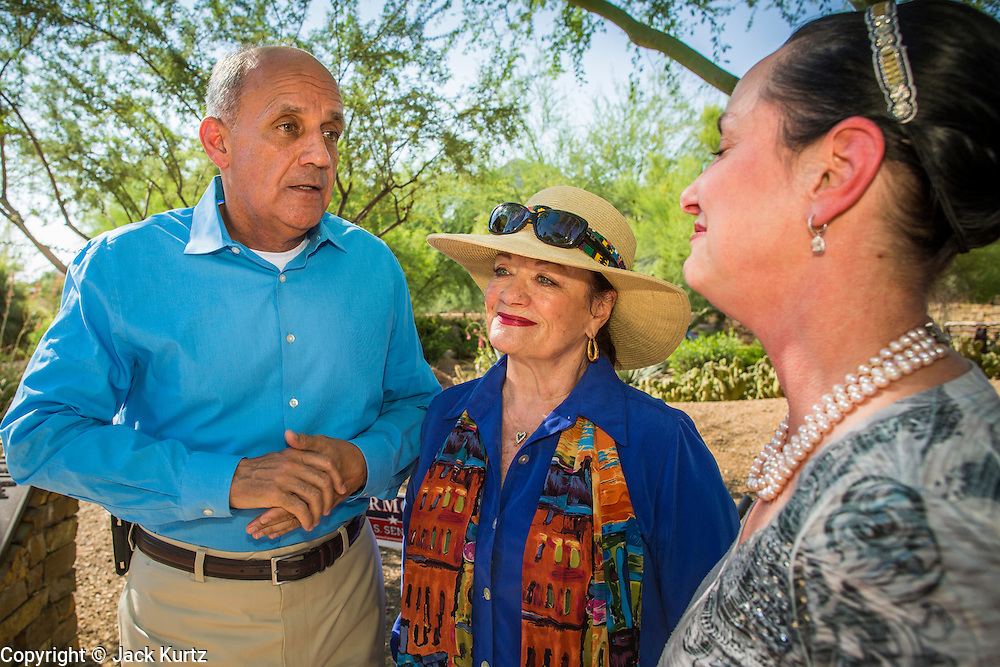 29 AUGUST 2012 - PARADISE VALLEY, AZ:   Dr. RICHARD CARMONA, Democratic candidate for US Senate from Arizona, talks to JOANNE GOLDWATER (center) and her daughter CC GOLDWATER after a press conference in Barry Goldwater Memorial Park in Paradise Valley, AZ, Wednesday. Carmona won the endorsements of Joanne Goldwater, daughter of Barry Goldwater, the late legendary Republican Senator from Arizona. He was also endorsed by CC Goldwater, her daughter, and Tyler Ross Goldwater, CC Goldwater's son. Barry Goldwater was from Paradise Valley.    PHOTO BY JACK KURTZ
