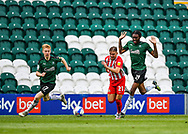 Sunderland Forward Jack Diamond (21) attacking and is on the ball while under pressure from Plymouth Argyle Defender Jerome Opoku (24) and Plymouth Argyle Defender Ryan Law (27)  during the EFL Sky Bet League 1 match between Plymouth Argyle and Sunderland at Home Park, Plymouth, England on 1 May 2021.