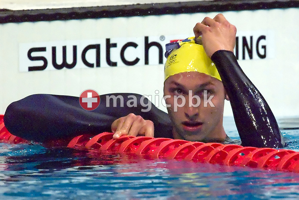 Ian THORPE of Australia celebrates after he won in a new world record time the men's swimming 400 metre freestyle final held at the National Aquatics Center at the Sydney 2000 Summer Olympic Games in Sydney, Australia, Monday, April 20, 2009. (Photo by Patrick B. Kraemer / MAGICPBK)