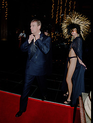 26 January 2002 - The Duke of York arrives at Andy & Patti Wong's Chinese New Year Party at The Reform Club, St.James's, London and is greeted by a near naked woman.<br /> <br /> Photo by Dominic O'Neill/Desmond O'Neill Features Ltd.  +44(0)1306 731608  www.donfeatures.com