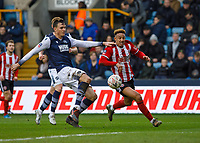 Football - 2019 / 2020 Emirates FA Cup - Fourth Round: Millwall vs. Sheffield United<br /> <br /> The long legs of Jake Cooper (Millwall FC) hook the ball clear before Callum Robinson (Sheffield United) can reach the ball at The Den.<br /> <br /> COLORSPORT/DANIEL BEARHAM