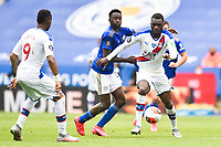 LEICESTER, ENGLAND - JULY 04: Wilfred Ndidi of Leicester City holds back Christian Benteke of Crystal Palace during the Premier League match between Leicester City and Crystal Palace at The King Power Stadium on July 4, 2020 in Leicester, United Kingdom. Football Stadiums around Europe remain empty due to the Coronavirus Pandemic as Government social distancing laws prohibit fans inside venues resulting in all fixtures being played behind closed doors. (Photo by MB Media)