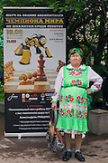 Moscow, Russia, 19/05/2012..A babushka watches the German-built KUKA Monster chess robot play Russia?s CHESSka robot for the title of Absolute World Robot Chess Champion. The Russian robot, developed by chess coach Konstantin Kosteniuk, comprehensively defeated its opponent, created by KUKA Robotics, one of the world?s largest manufacturers of industrial robots.